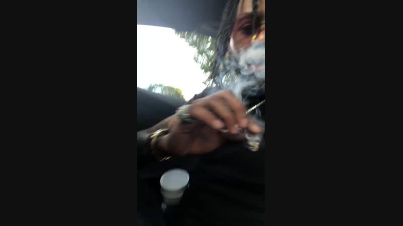 Hoodrich Pablo Juan smoking Backwoods