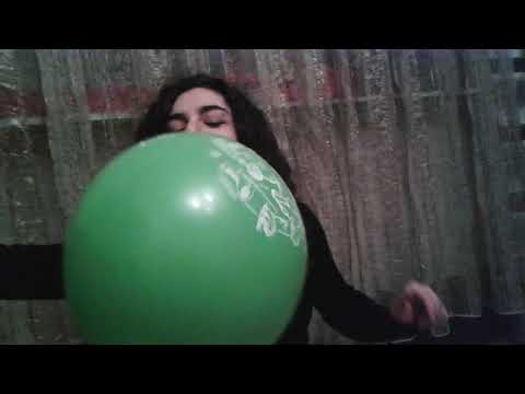 Hookah smoking girl tries the balloon challenge blow to pop