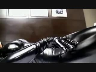 Asian in latex catsuit gloves boots