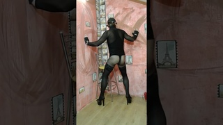 LEGION GIMENEUS, black turtleneck bodie strings in a small net, pantyhose, stockings, heels
