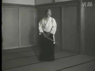 Morihei_Ueshiba_demonstrating_aiki-ken_at_the_Aiki-shrine.mp4