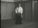 Morihei Ueshiba demonstrating aiki ken at the Aiki