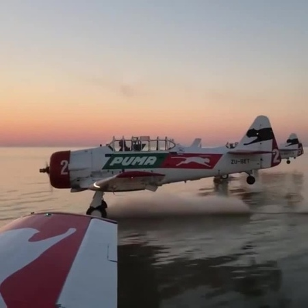 Water skiing in a plane