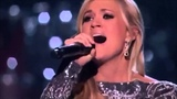 Carrie Underwood, sings, How great thou art.
