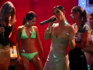 Bikini Clad Girls wrestling in the green slime pit