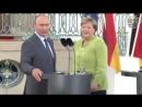 Меркель заговорила по-русски.