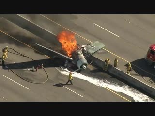 Aerial footage of plane crash in Agoura Hills, California; the pilot manage