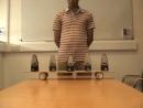 Синхронизация 5 связанных метрономов выполнено в Университете Ланкастера