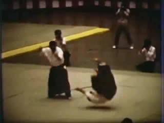 Saito Sensei at the 1981 All Japan Demo, assisted by Robert Okun & Bernice Sensei.