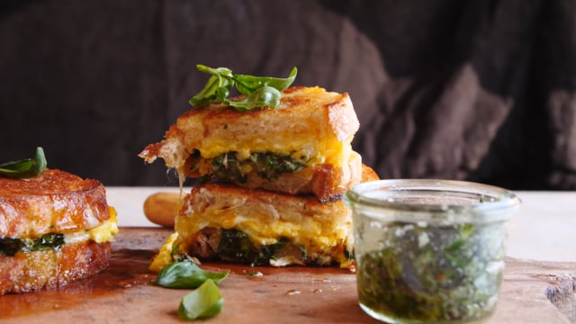 Breakfast grilled cheese with soft scrambled eggs and pesto