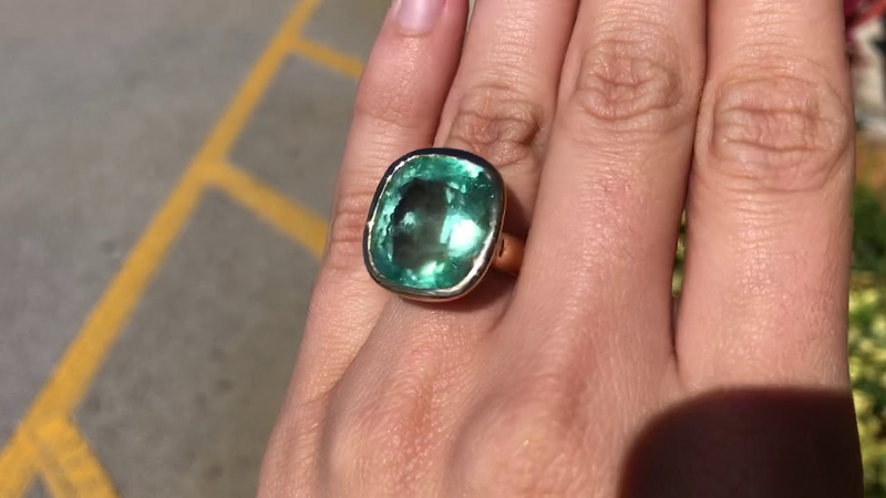 Huge 20.10 carat Colombian emerald ring in 3 different natural day light settings