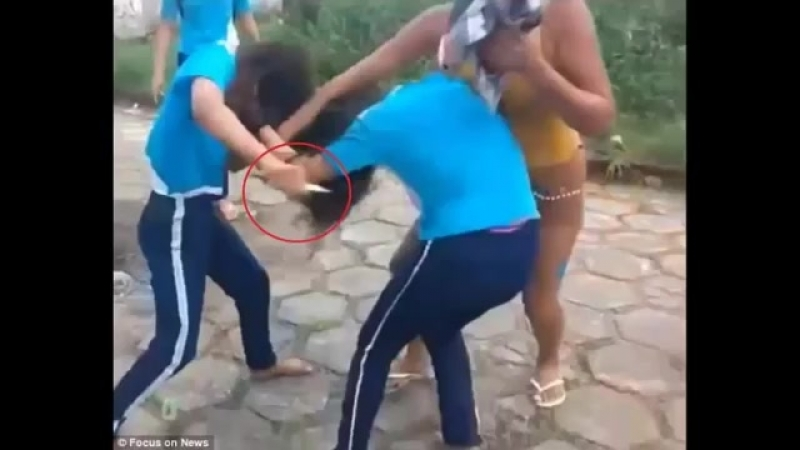 Girl slashes her friend during brutal school fight in Brazil