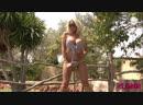 Glamour blonde Cara Brett undresses