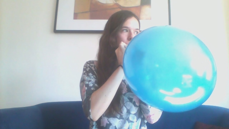 Blue balloon loud blow to pop girl