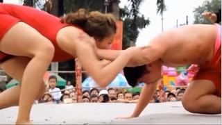 A woman defeats a man at Vietnam Traditional Wrestling Event