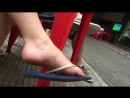 Candid red nails feet dangling