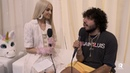 Poppy Asks Benny Blanco the Tough Questions At The 2018 AMAs (EXCLUSIVE)