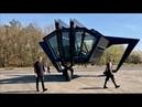 Black mantis vehicle uses Cold War hangar as creative burrow