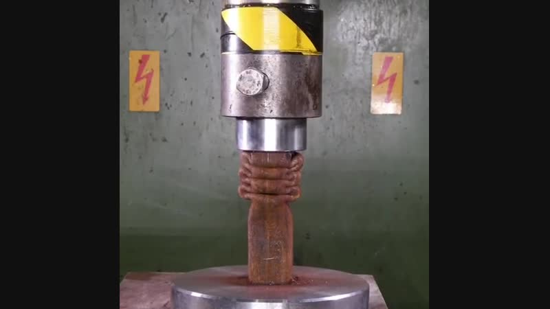 Metal pipe being crushed