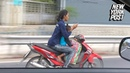Woman boldly texts and drives with a kid on her bike