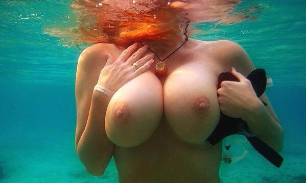 Busty milf teasing and fucking a dildo