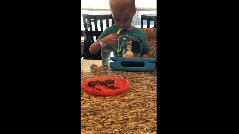 My nephew eating water with a fork.