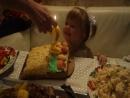 Екатерина задувает свечи на свой второй день рождения))