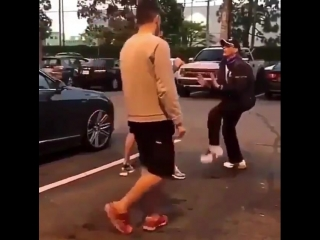 Nate Nick working with Jean-Claude Van Damme in a parking lot - - The MMA world is fucked