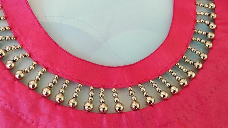 Very creative beaded design latest boat neck design for kurti