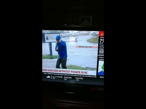 So dramatic! Dude from the weather channel bracing for his life, as 2 dudes just stroll past.