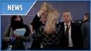Bizarre moment Juncker ruffles woman's hair