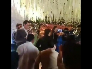 Shah rukh khan poses for photographers at the wedding reception of purna patel