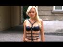 Sexy blondine is walking outside in a kinky black mini dress