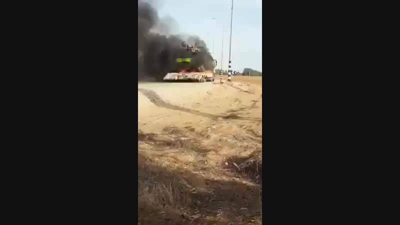 Please enjoy this video of an Israeli tank, which caught on fire outside of Gaza today. httpst.co.mp4
