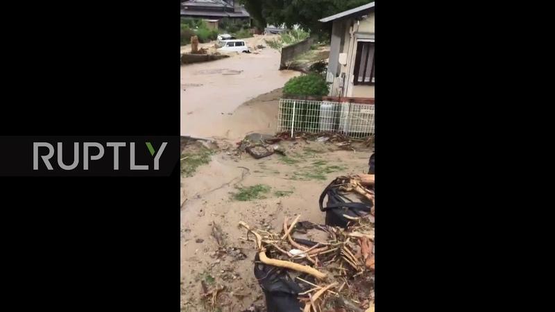 Japan Floodwaters batter Hiroshima prefecture