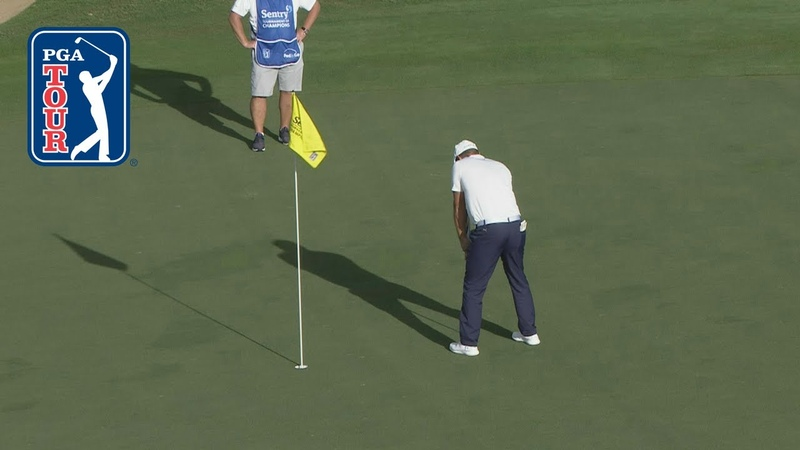 Bryson DeChambeau putts with flagstick in at Sentry 2019