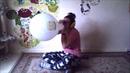 Pyjama girl blows to pop minion balloon