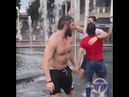 Capitals players dive into the fountain at the Georgetown Waterfront