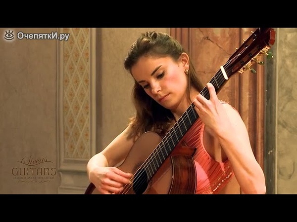 Девушка и испанская гитара