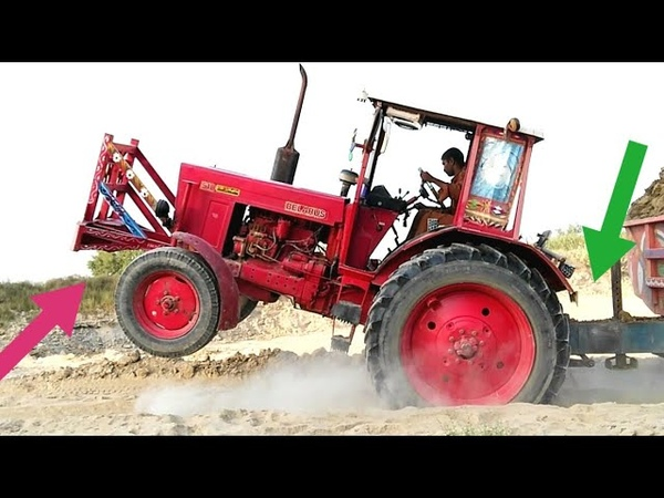 Dangerous Belarus MTZ 510 Tractor stunt with mud loded trolley
