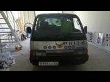 136-й авто криптовалюты Prizm в Новосибирске, Серебристый Nissan Caravan, м933ех, 54 Rus