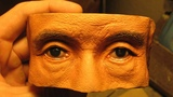 The view of Takeshi Kitano. Woodcarving. Fragment of the sculpture. Realistic eyes and skin