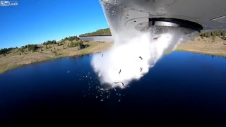 Utah department of wildlife drop fish from plane to Restock lake