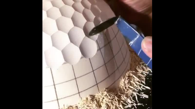 Hand carving a porcelain pot