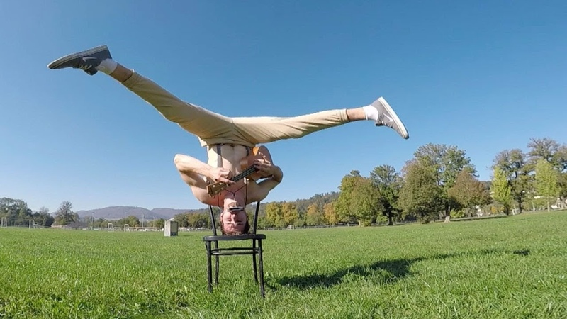 Man Plays Ukulele Whilst Doing A Headstand