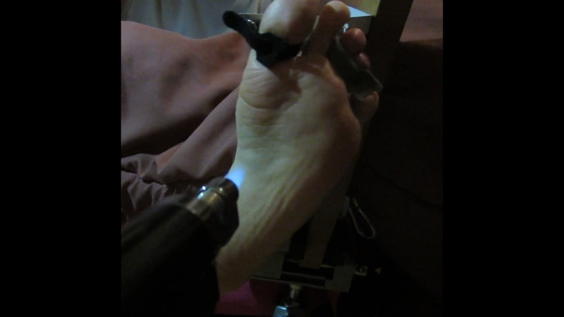 Foot torture by blowtorch on the stock, after bastinado