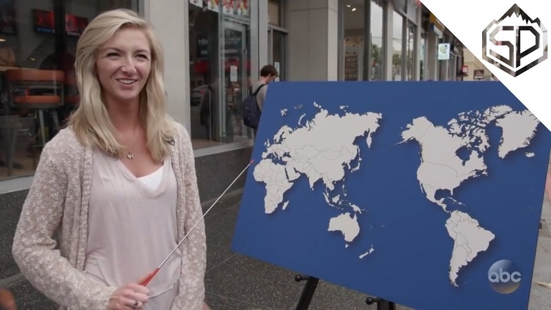 Прохожие пытаются показать местонахождение стран на карте
