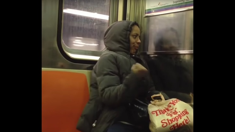 Crazy lady doesn't like anyone on the NYC subway.