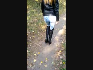 Girl in boots trample mushrooms