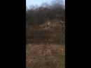 Man ghost riding a KTM drops his motorbike halfway up hill. Motorbike knocks his friend down hill.